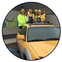 Element employees dressed up as minions in the back of a Subaru